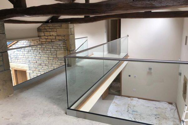 Internal Glass Balustrade. Track & top rail